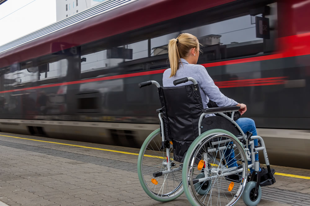disabled woman waiting to board a train