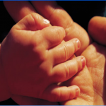 child's clasped hands