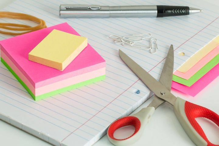 colourful post it notes next to a pair of scissors